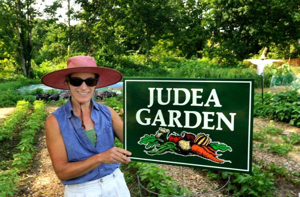 Denise with Judea Garden sign